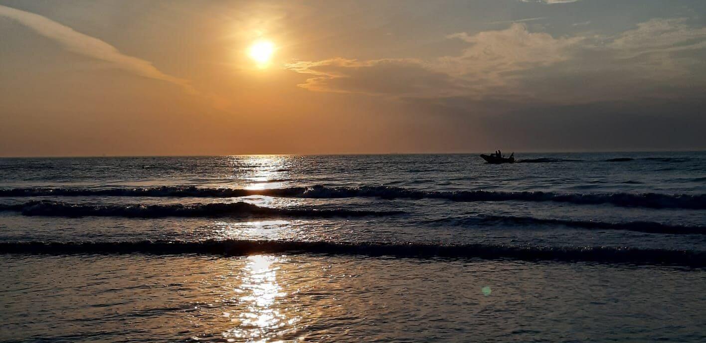 Zonsondergang met bootje